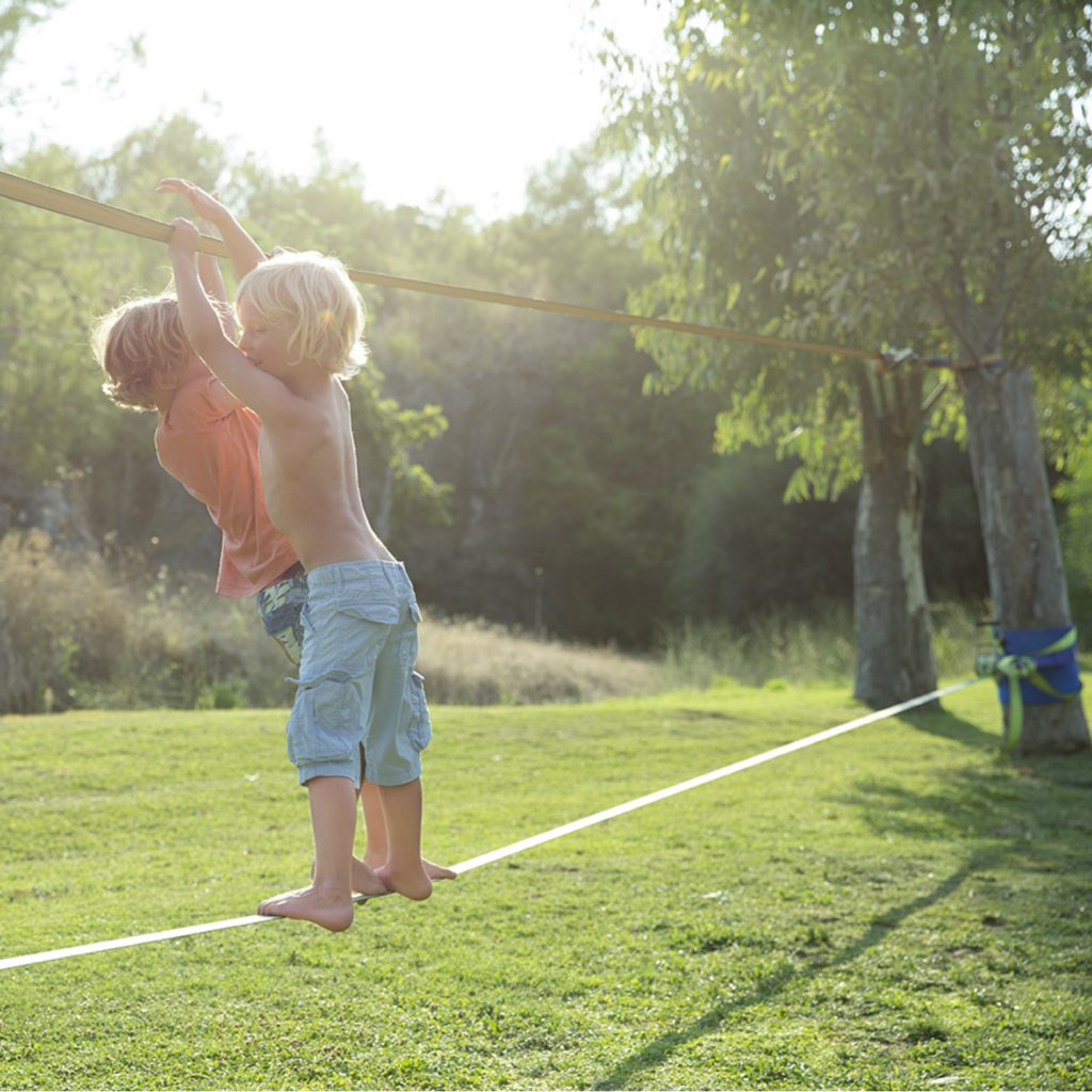 Children doing slacklining