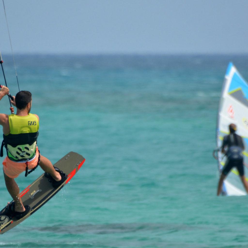 Kitesurfers and windsurfers on the water
