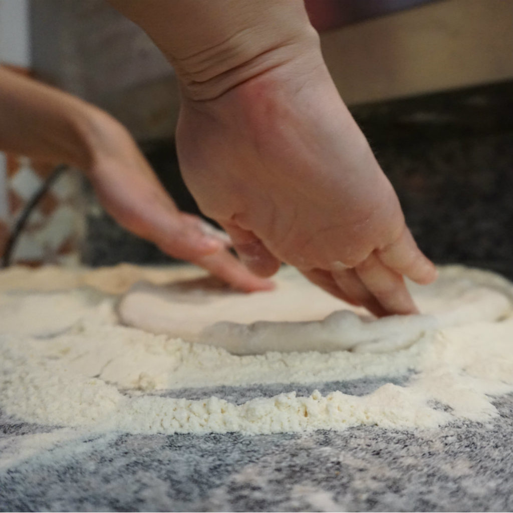 Knead out the pizza dough.