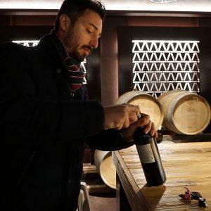 Winemaker Matteo Mosti at a wine tasting in Castelfalfi