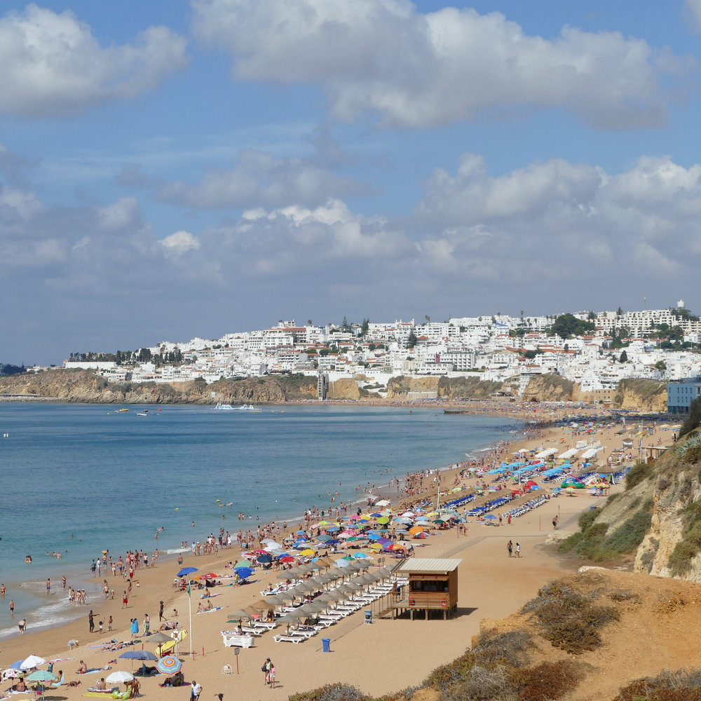 Town of Albufeira bathers on the beach