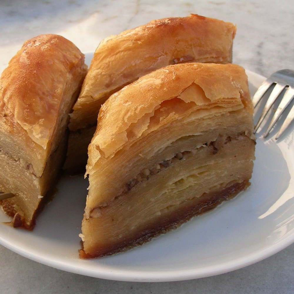Baklava pieces on plate with fork