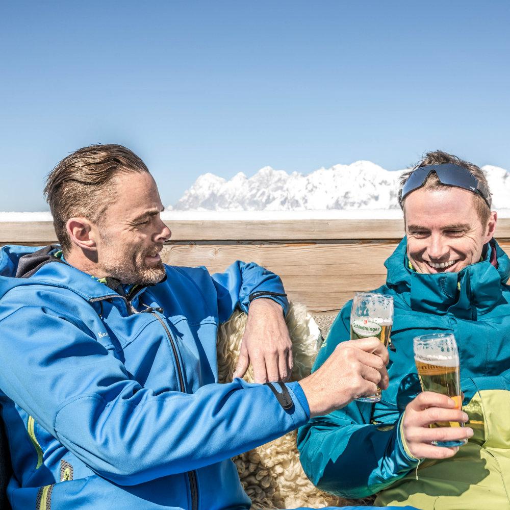 Men toast with beer