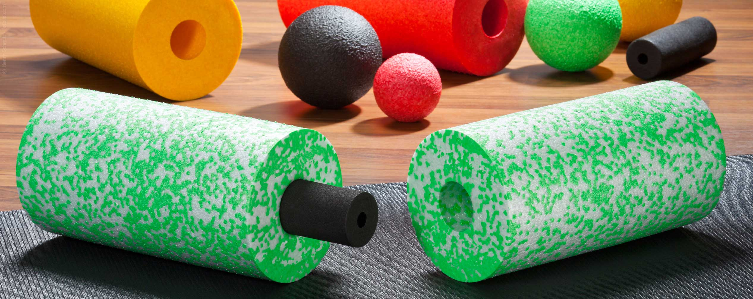 Coloured fascia rollers and massage balls