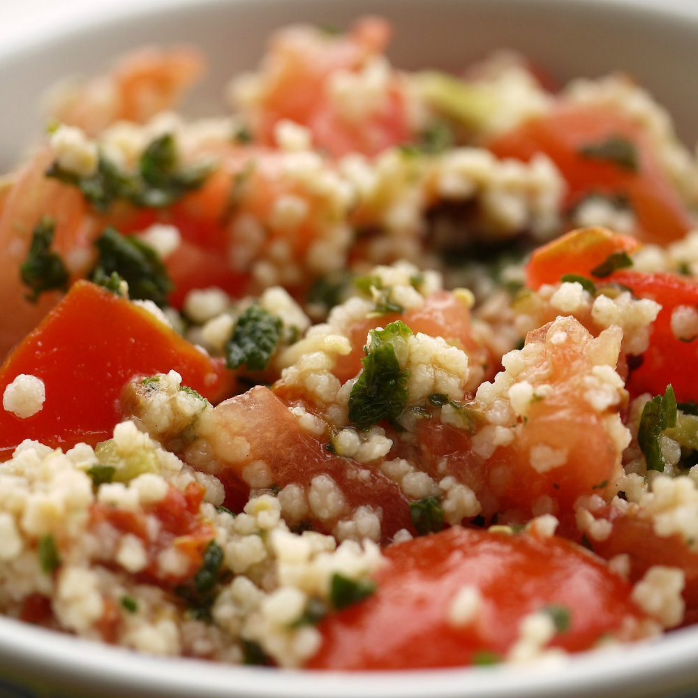 Cup of couscous with tomatoes