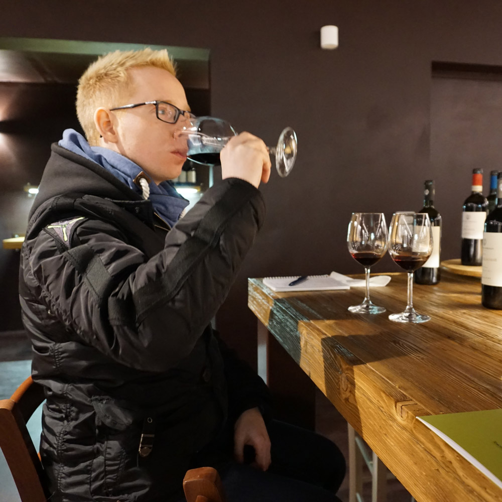 Dirk sipping wine at the Castelfalfi wine tasting