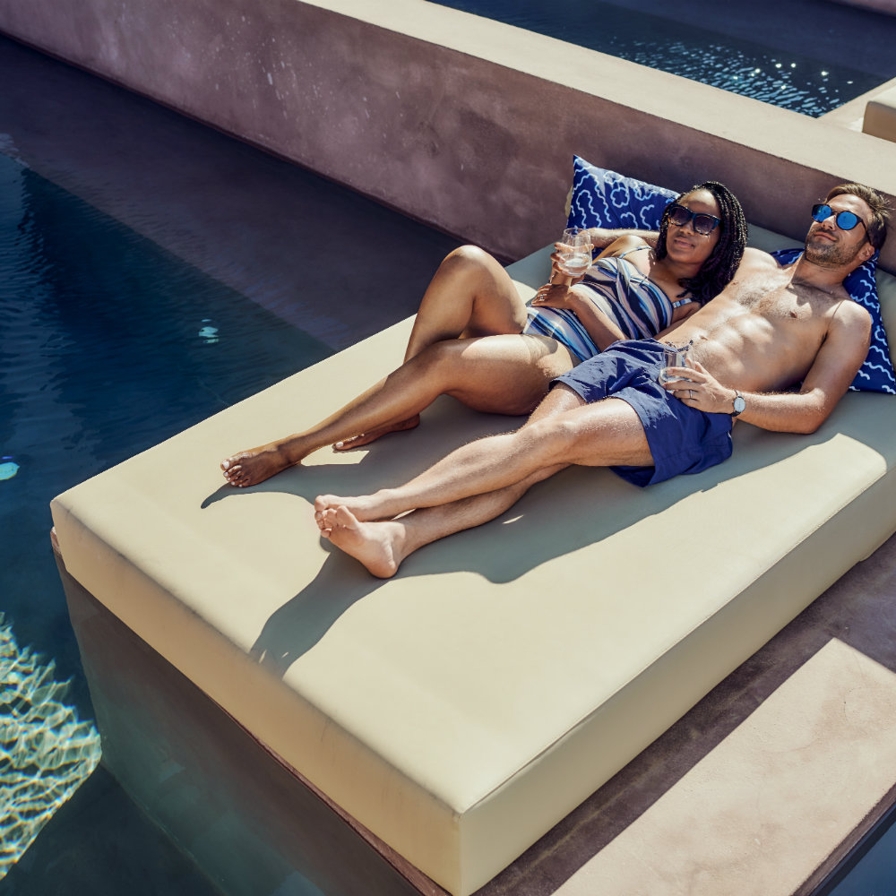 Couple relaxes by the pool