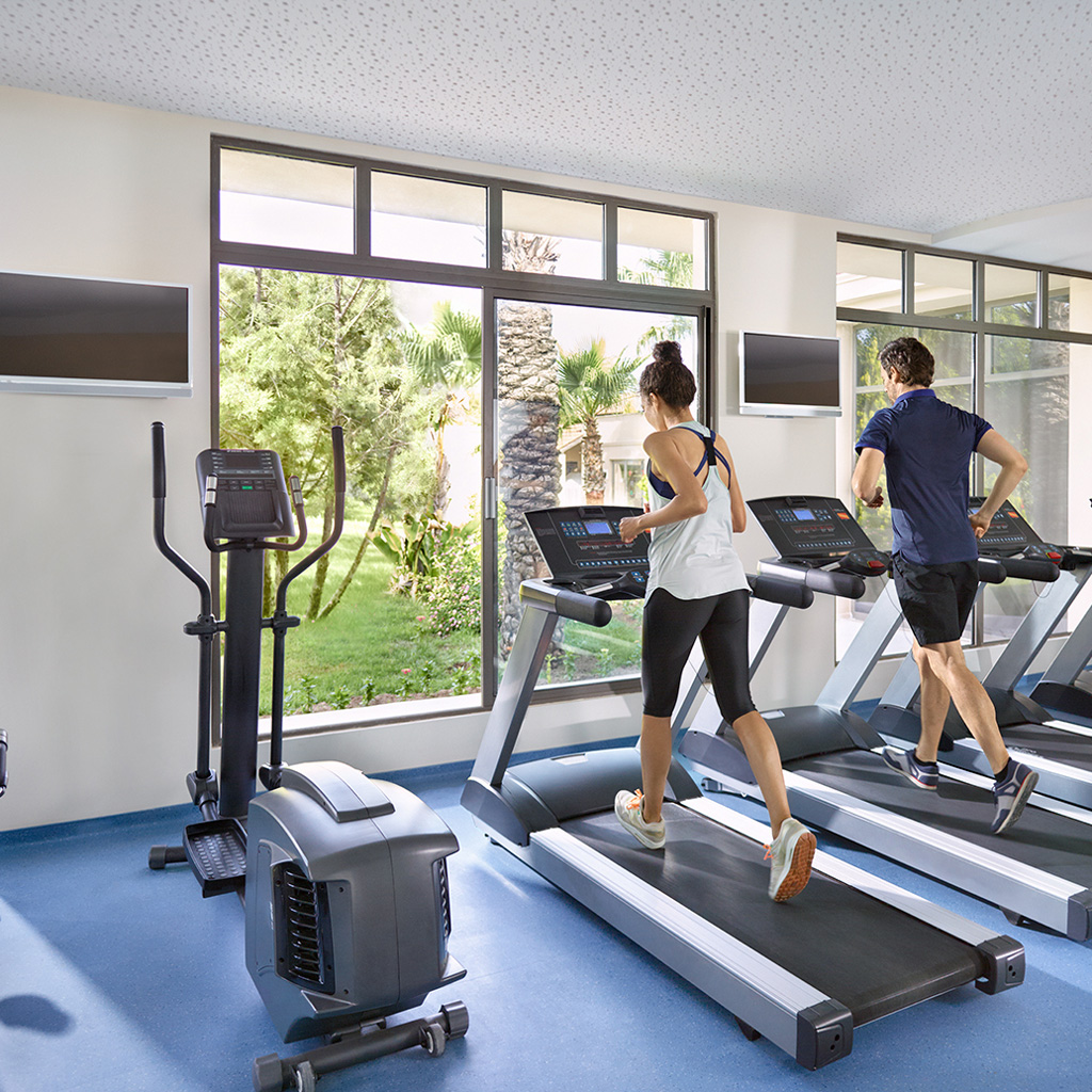 woman and man exercising on treadmill