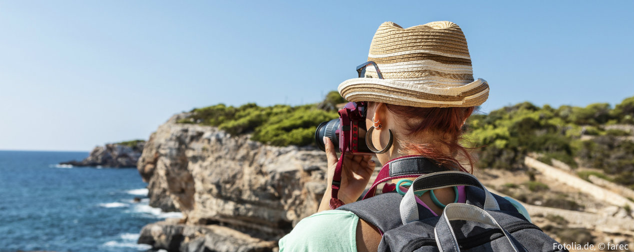 woman takes picture of viewpoints in mallorca
