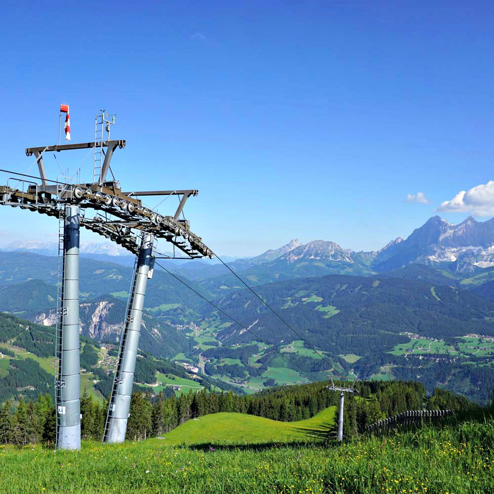 hochwurzen chair lift with the dachstein massif in the background