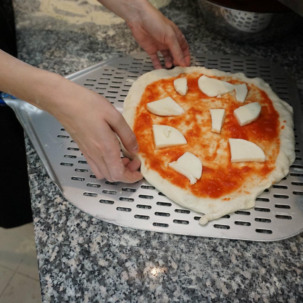 Pizza dough loaded with mozzarella