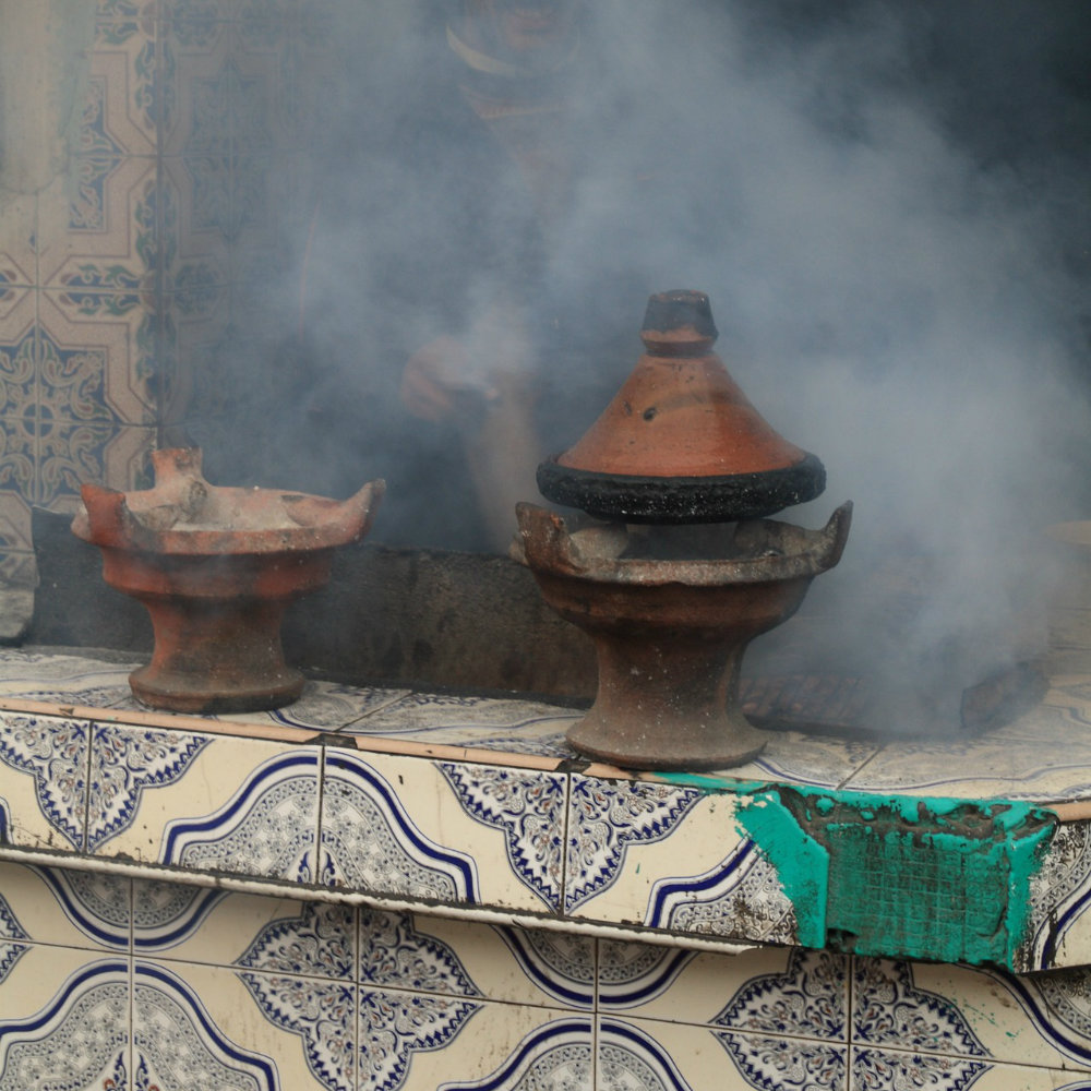 Tajine on open fire smoke