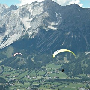 tandem flying paraglider Alpine views