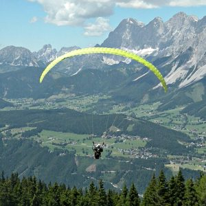 tandem flying paraglider Alps panorama