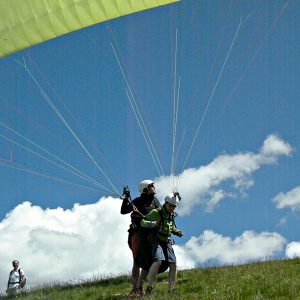 tandem flying paraglider running start