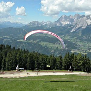 tandem flying paraglider planai start