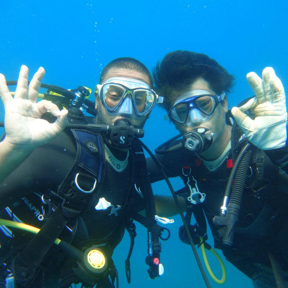 diver diving sign OK